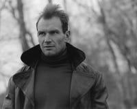Pensive guy portrait. Trench coat. Outdoor shoot Stock Image