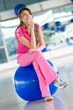 Pensive gym woman Royalty Free Stock Images