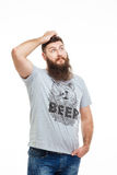 Pensive handsome bearded man scratching his head and thinking Royalty Free Stock Image