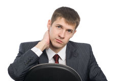 Pensive handsome young businessman. Isolated on white Royalty Free Stock Photo