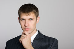 Pensive handsome young businessman Stock Images