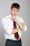 Pensive handsome young businessman Stock Photo