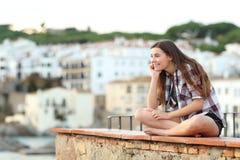 Pensive teen contemplating hozizon in a town stock photo