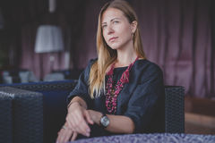 Pensive happy woman remembering looking at side sitting in a bar terrace Stock Photos
