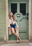 Pensive hippie woman in boho clothes standing outdoors Stock Photography