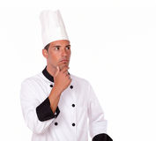 Pensive hispanic chef looking at people Royalty Free Stock Image