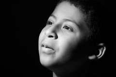Pensive Hispanic Child on Black Background Royalty Free Stock Photo