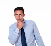 Pensive hispanic man looking at you Stock Photography