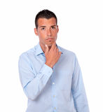 Pensive hispanic young man looking up Stock Photo