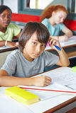 Pensive Japanese child in class Royalty Free Stock Photography