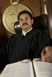 Pensive Judge In Courtroom Stock Photo