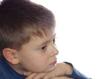 Pensive kid. Thoughful boy portrait isolated over white background Stock Photography