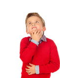 Pensive kid with red jersey Royalty Free Stock Photos
