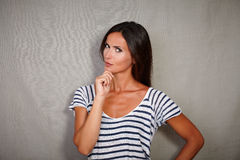 Pensive lady contemplating while looking at camera. Pensive lady in casual clothing contemplating while looking at camera Stock Photos