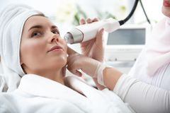 Thoughtful girl getting treatment of skin stock photo