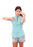 Pensive lady in short jeans with thumb down Stock Images