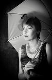 Pensive Lady with an umbrella Stock Photo
