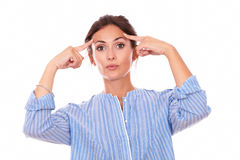 Pensive lady wondering while looking at you Stock Images
