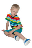 Pensive little boy in the bright shirt Royalty Free Stock Photography