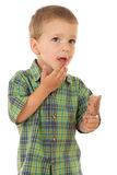 Pensive little boy with chocolate ice cream Stock Image