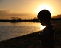 Pensive little boy by the sea Stock Photos