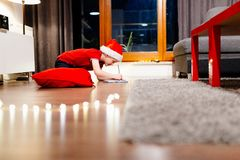 Pensive little boy writing a letter to Santa Claus Stock Image