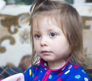 Pensive little girl Stock Images