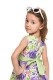 Pensive little girl looks back royalty free stock image