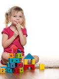 Pensive little girl near toys Royalty Free Stock Photo