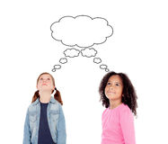 Pensive little girls thinking Royalty Free Stock Images