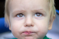 Pensive look of a child Stock Photos