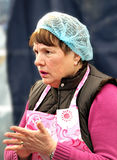 Pensive looking dinner lady Stock Photos
