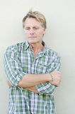 Pensive looking man. Color portrait photo of a pensive and depressed looking mature man in his forties wearing a green checked shirt Royalty Free Stock Photography