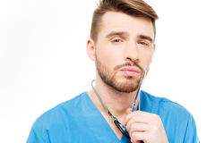 Pensive male doctor Royalty Free Stock Photography