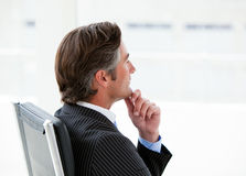 Pensive male executive sitting in his office Stock Images