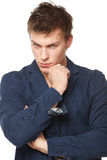 Pensive male standing with folded hands Royalty Free Stock Photography