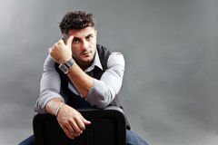 Pensive man. Pensive young man in stress, looking straight Royalty Free Stock Photos
