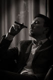 Pensive man with cigar Stock Image