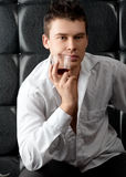 Pensive man with glass of whiskey Stock Photography