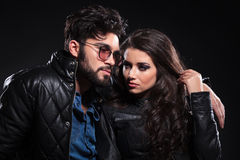 Pensive man with glasses and long beard embracing his girlfriend Stock Photo