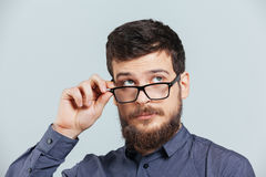 Pensive man in glasses looking up Stock Images