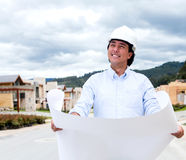 Pensive man holding blueprints Stock Image