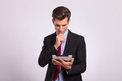 Pensive man holding tablet Stock Photography