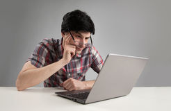 Pensive man with laptop Royalty Free Stock Image