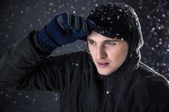 Pensive man looking away with snow Stock Photos