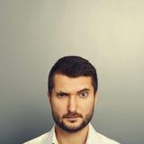 Pensive man. Looking at camera Stock Image