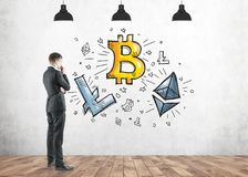 Pensive man looking at cryptocurrency, bitcoin Stock Images