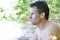 Pensive man in nature Stock Images