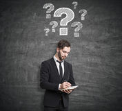 Pensive man near question mark Royalty Free Stock Photography