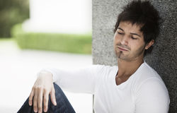 Pensive man outdoors Royalty Free Stock Image